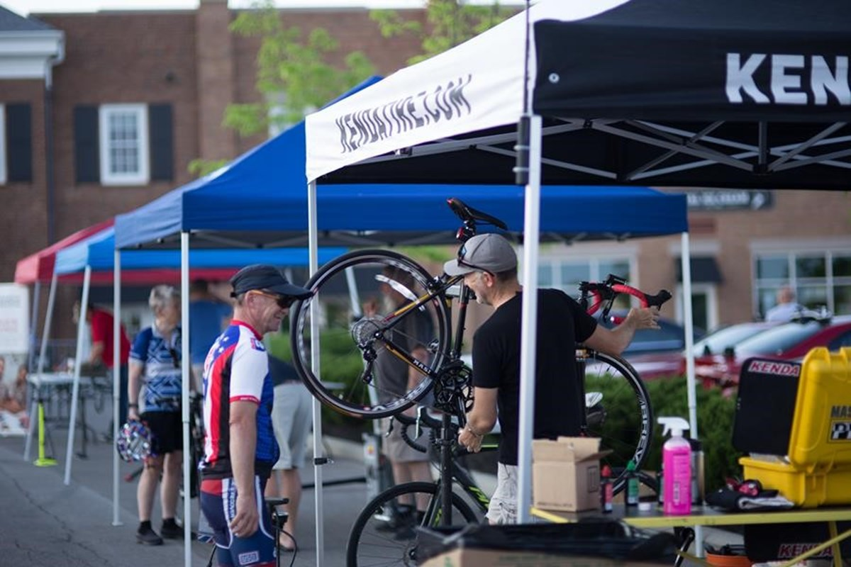 Director of Marketing, Ben Anderson, helping prepare riders bikes before the Honor Ride.