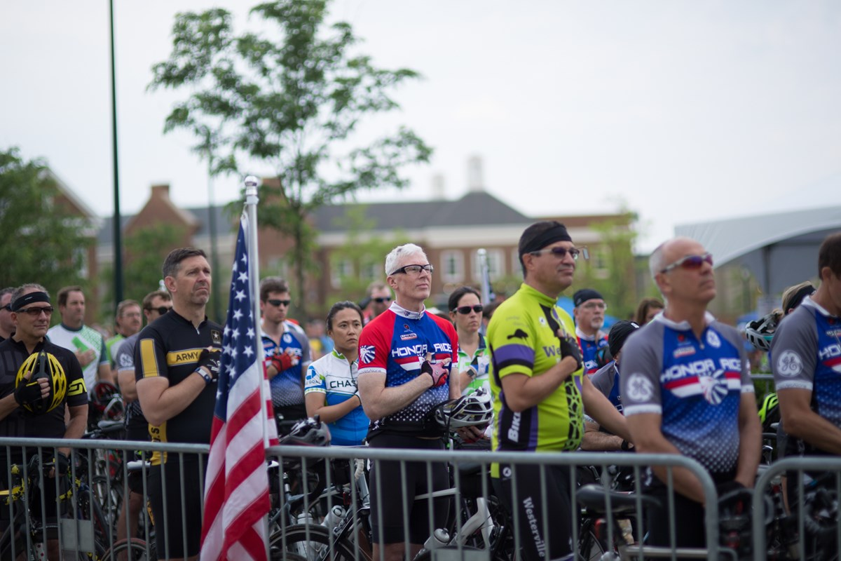 Rider pause for the National Anthem prior to the start of the 2018 New Albany, OH Honor Ride.
