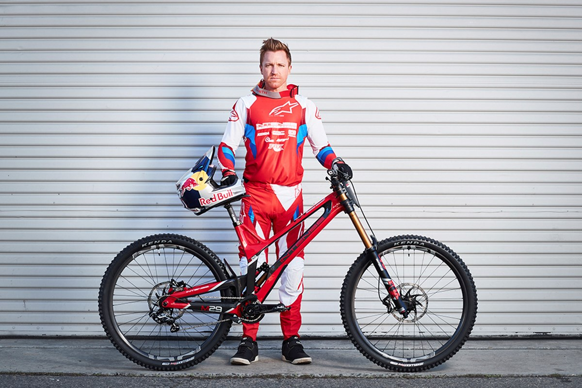 Aaron Gwin with his Intense M29 and Kenda Hellkats